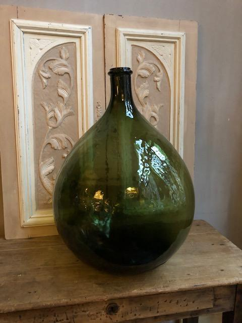 Vintage groene bolle gistfles