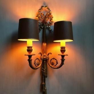 Statige messing wandlamp goud met strik