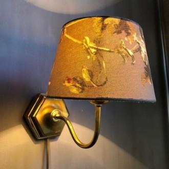 Messing wandlamp met florale kap